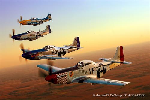 A flight of P-58 Mustangs at sunset.