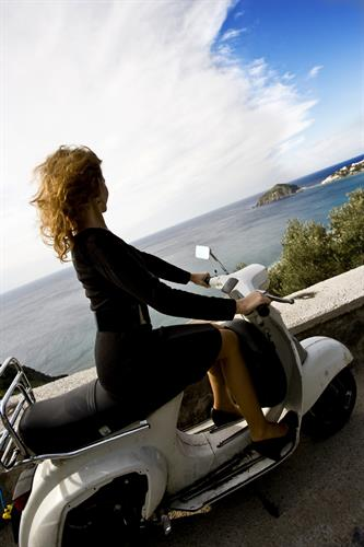 Gallery Image Woman_on_scooter_overlooking_ocean.jpg