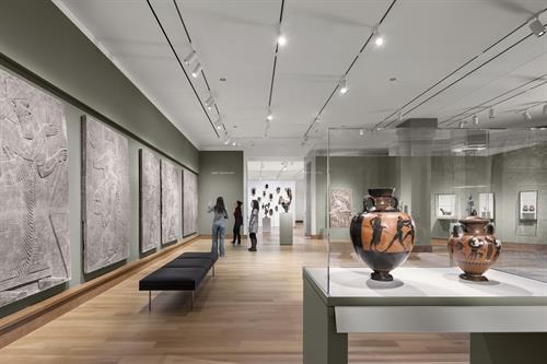 An installation of global ancient and premodern art in the newly renovated Kim Gallery, with an installation of traditional African art in the Albright Gallery beyond. Photograph © Michael Moran.