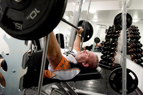 Our gym is open 24/7 and offers cario equipment and free weights