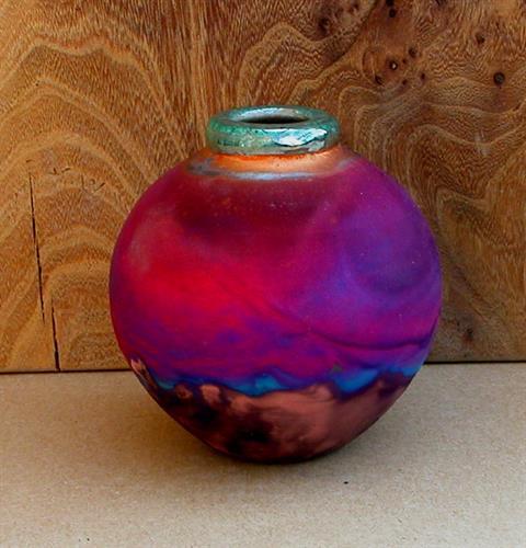 Copper fumed raku vase handmade by Simon Eeles.