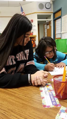 One of our 8th grade Dreamer Scholars helps out one of our La Vista Dreamer Scholars (2nd grade) with her homework. We love it when our older students get to interact and volunteer with our younger students!