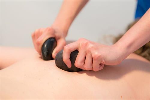 We offer full body hot stone massages as well as a hot stone add-on!