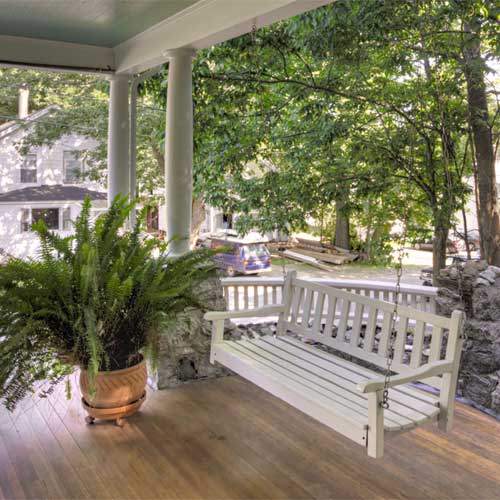 Jeweled Turret Inn Porch Swing