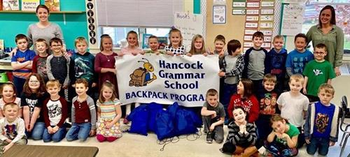 Visiting with the Hancock Grammar School and helping them with their Backpack Program.