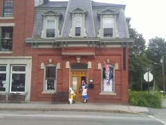 Alice and the White Rabbit outside the historic bank building in Searsport