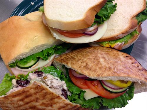 sandwiches made with fresh veggies, meat and cheese sliced at the cafe and bread from Ed's Bread