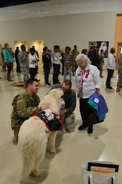 Denver the Service Dog and Auxiliary Member Lynn visit with the Soldiers of B Co, 151st .Expeditionary Signal Battalion.