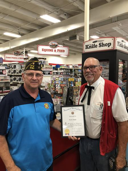 Commander Sudik presenting Certificate of Appreciation to Tractor Supply Company for their support of VFW Post 8131 Buddy Poppy Distribution.