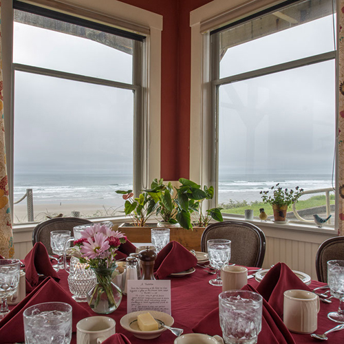 The Sylvia Beach Hotel's Tables of Content Restaurant offers nightly seatings of a prix-fixe, four-course dinner made from scratch using local ingredients.