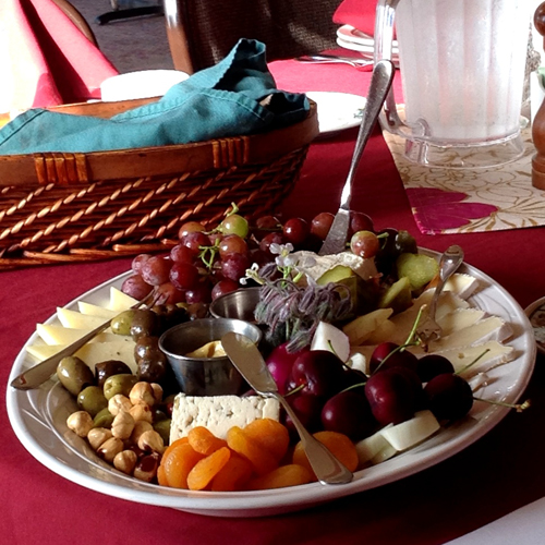 Appetizer plates often feature the bounty of the seasons – fruit, nuts, fresh herbs, local seafoods, for example.