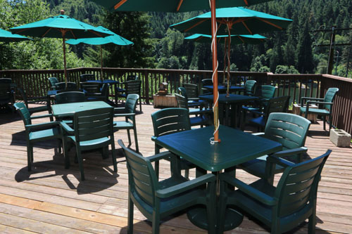 The deck overlooking Loon Lake is the perfect place to enjoy a fresh ice cream cone from the deli at Loon Lake Lodge