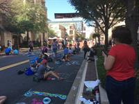 "Families ""chalking"" at ChalkFest at Reston Town Center 2017"