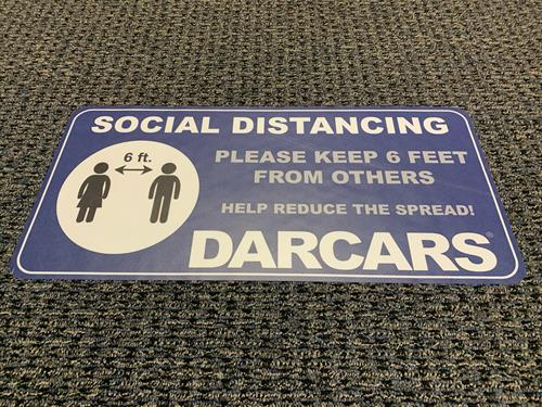 Floor decals for social distancing produced by Allegra