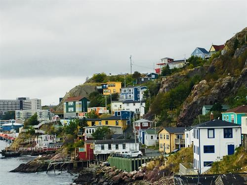 The Outer Battery These houses and fishing stages are anchored to the rocks at the base of Signal Hill.