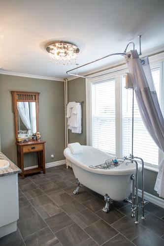 The Teresa & Beth ensuite bath boasts a clawfoot tub/shower combo, complete with bubble bath and place to hold your wine glass!