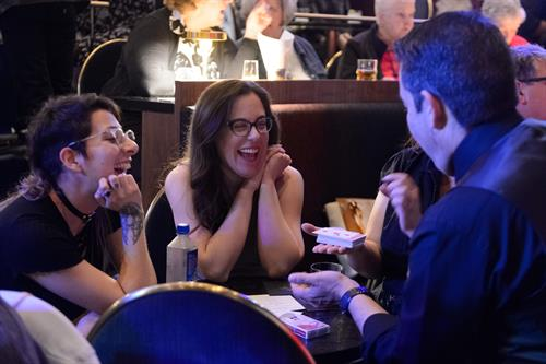 Audience enjoying table magic at Chicago Magic Lounge