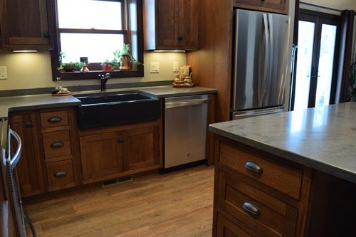Quartersawn Oak cabinetry with Corian tops