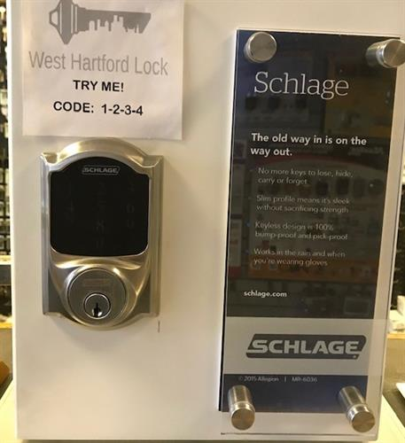 Touch pad deadbolt with traditional key backup.