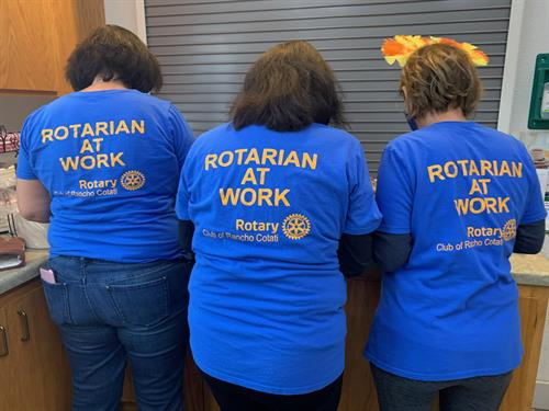 Rotarians helping serve early Thanksgiving dinner at Charles Street senior complex
