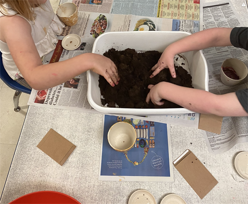 Planting seeds in small groups.