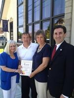Supervisor Bosworth and Town Clerk Wayne Wink with Donna and Tom Rice celebrating our newly renovated building
