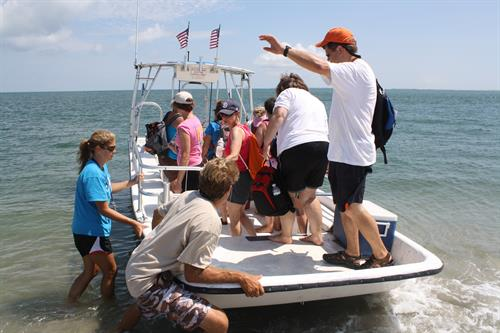 Tour group departing onto Portsmouth Beach