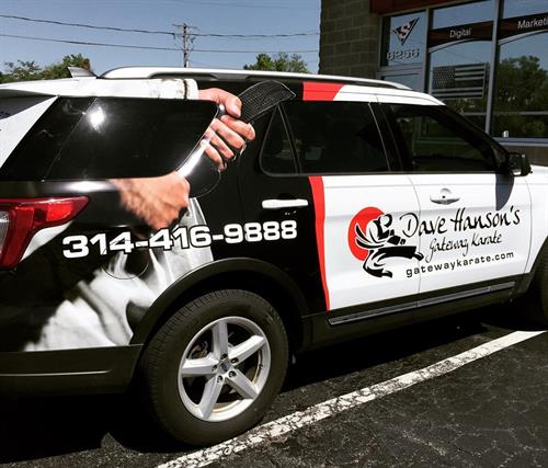 Vehicle lettering and partial wrap