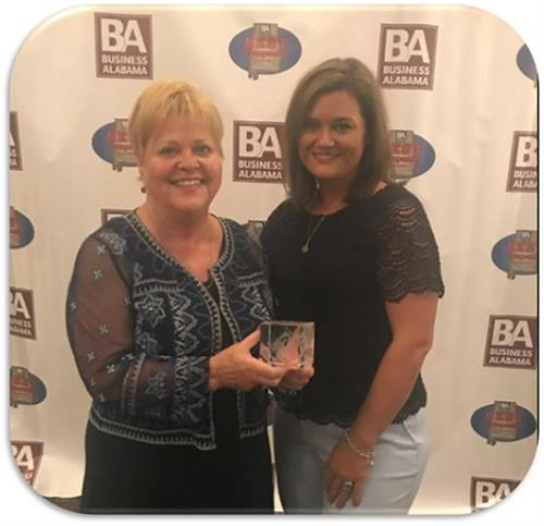 Sheila & Michelle Hodges accepting Best Company Award from Business Alabama