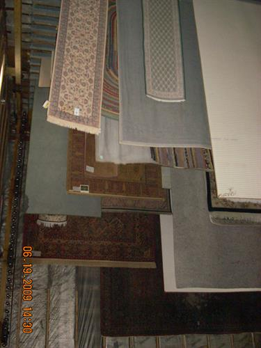 Clean rugs hanging in controlled dry room