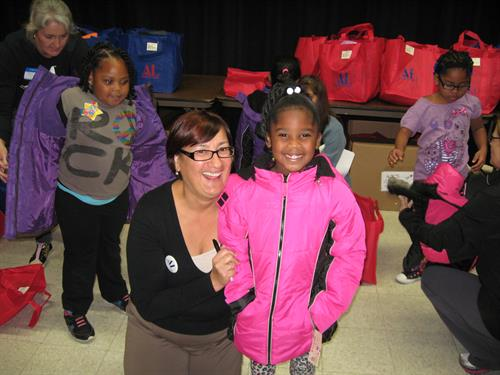 Students receiving new winter coats through Operation School Bell