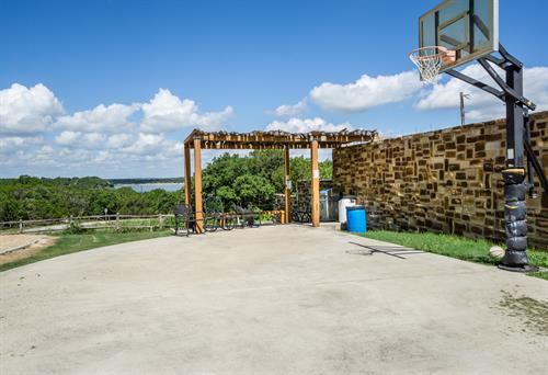 Basketball and Sand Volleyball Courts and cabana picnic area to eat with lake view