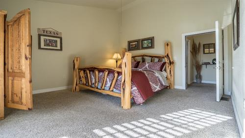 Large Master Bedroom upstairs with King Size bed & Pillow top mattress TV and more