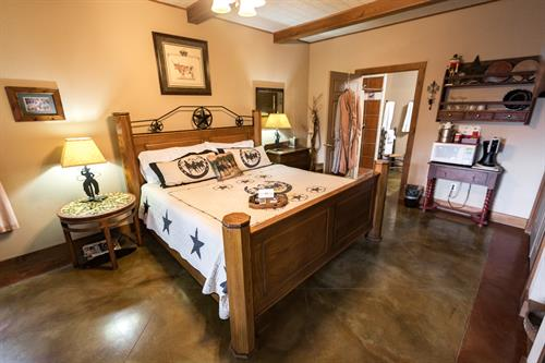 The western flair of the Lone Star Suite, with sofa, fireplace and private hot tub.Our first floor ADA accomidation room with duel shower heads.
