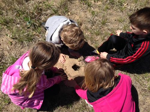 What made the hole? Who lives there? Students explore the refuge's prairie.