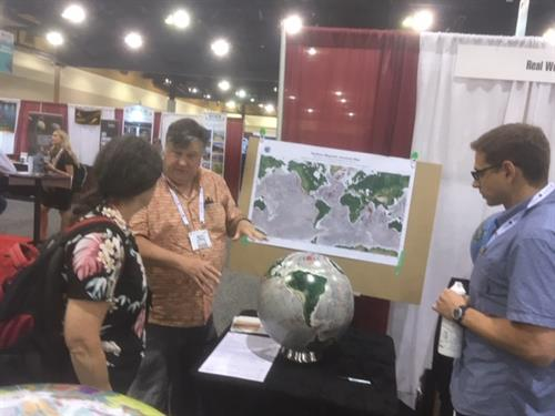 Geology meeting booth discussion with Penn State and Univ Houston