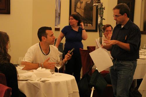 Discussing a scene with actors, Joe Cassese and Alison Parks, on Acoustic Space.