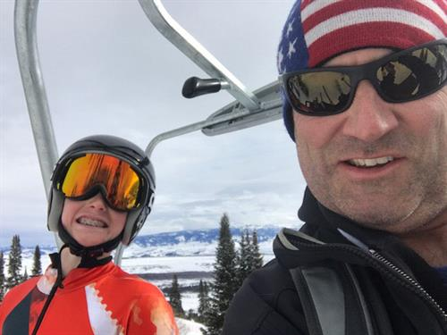 Ryan Witt of Witt Law Group with son at a ski race in Jackson Hole WY