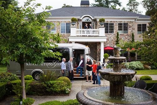 Gallery Image Bus_photo_with_people_and_manor.jpg