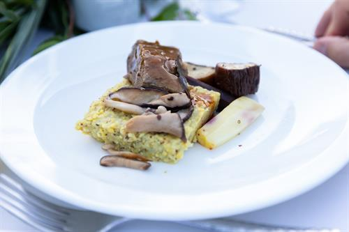 Short Rib with Red Wine Demi, chantrelle mushrooms, and polenta cake