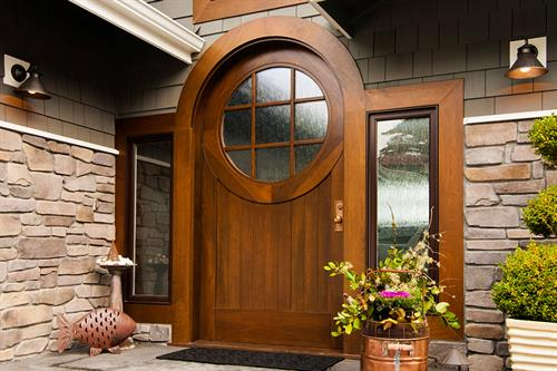 Custom entry door featuring circular top