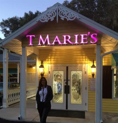 T Marie Benchley in front of store