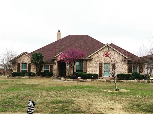 Beautiful Haslet home, roof done by S.W.A.T Roofing & Contracting