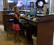 Rylee learning how to work the front counter