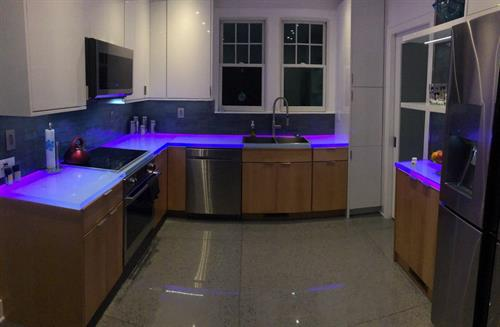 Glass LED-lit countertops at night!