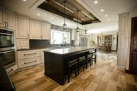 Custom Farmhouse Kitchen with Barnwood Ceiling Accent