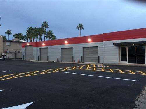 The remodeled front of the front shop.  Used to be a carwash.  There is also a 6 bay shop in the back.  10 bays all together