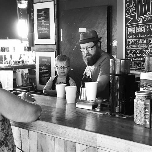 A little future barista in training