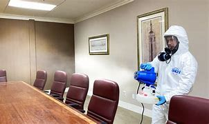 Disinfecting an attorney's conference room.