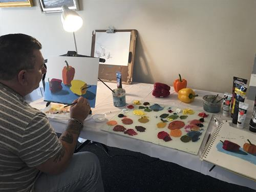 Beginner student working on acrylic painting foundations